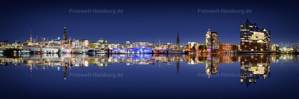 10190502 - Hamburg Skyline | Hamburgs Skyline bei Nacht mit besonders eindrucksvoller digital erstellter Spiegelung.